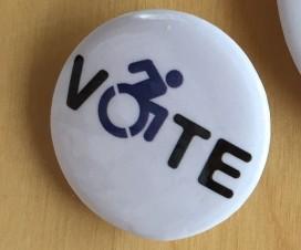 """Imagen de chapita con la palabre """"vote"""""""